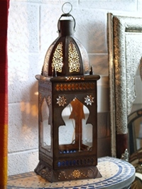 tall handmade moroccan lantern with clear and coloured panels.