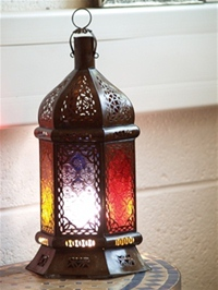 moroccan candle lantern with coloured glass.