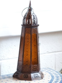 moroccan candle lantern with amber coloured panels.