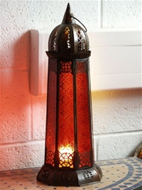 handmade moroccan candle lantern with red panels.