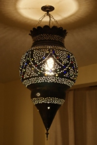 stunning aged brass moroccan lantern with coloured glass.