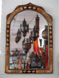 moroccan mirror with decorated bone design.