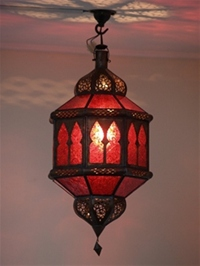 moroccan lantern with red coloured panels.