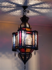moroccan lantern with clear and red coloured panels.