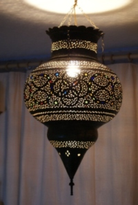 stunning large aged brass moroccan lantern with coloured glass.