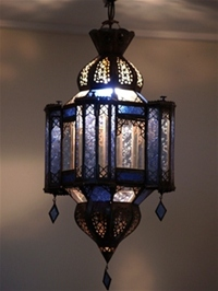 moroccan lantern with clear and blue coloured panels.