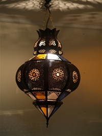 beautiful moroccan lantern combining the effects of perforated metal design and coloured glass.