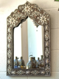 beautiful moroccan mirror with silver detail.