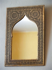 moroccan mirror in brass frame.