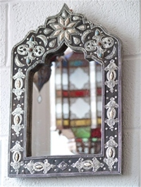 beautiful moroccan mirror with silver detail enhanced by coloured resin beads.