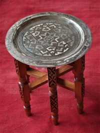 moroccan silver coloured tea tray table with wooden legs.