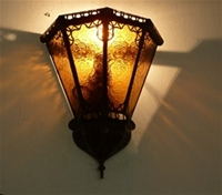 moroccan wall lamp with amber coloured glass.