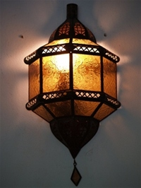 moroccan wall lamp with amber coloured panels.