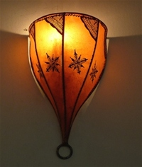 moroccan amber henna wall lamp with henna design.