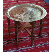 moroccan brass coloured tea tray table with wooden legs.