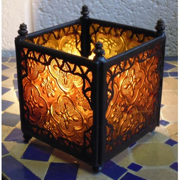 square candle lantern with amber coloured glass.