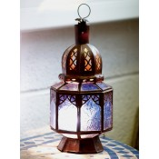 moroccan candle lantern with amber coloured glass.