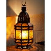 moroccan candle lantern with amber coloured glass panels.