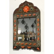 moroccan mirror with decorated leather & silver design frame.