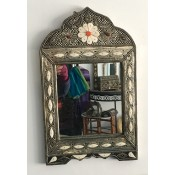 moroccan mirror with white and amber coloured detail on a silver frame