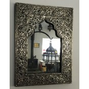 moroccan mirror with decorative silver frame.