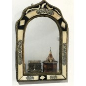small moroccan mirror with decorated bone design.