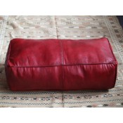 large red moroccan leather pouffe cushion.