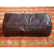 large rectangular brown moroccan leather pouffe.