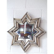 moroccan star shaped mirror with silver frame