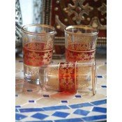a set of 6 red moroccan tea glasses.