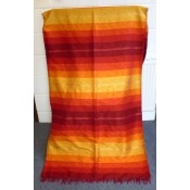 moroccan fabric throw in orange shades.