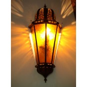moroccan wall lamp with amber coloured glass panels.